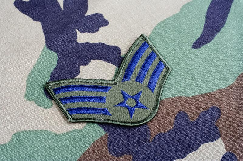 US AIR FORCE Senior Airman rank patch on woodland camouflage uniform. Background stock photography