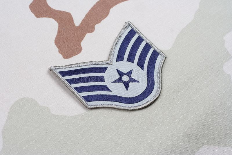 US AIR FORCE Staff Sergeant rank patch on desert uniform. Background stock photography