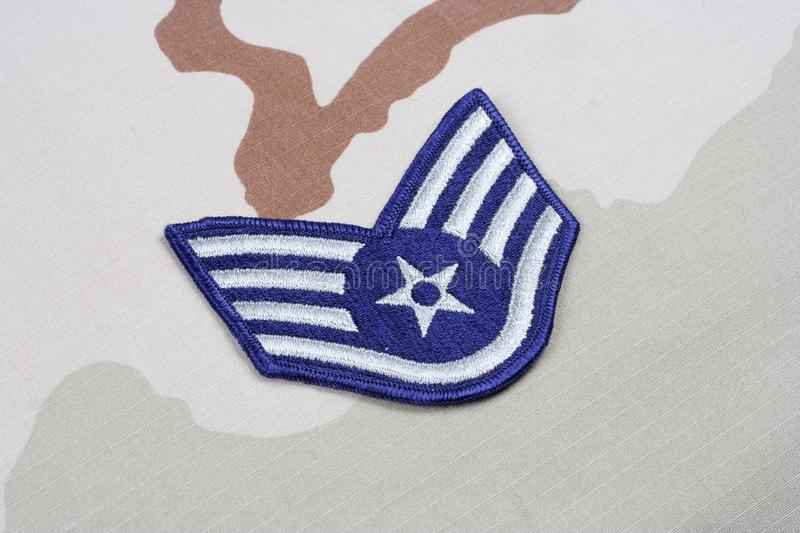 US AIR FORCE Staff Sergeant rank patch on desert uniform. Background royalty free stock photo