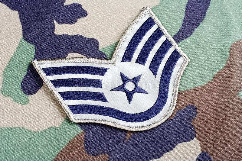 US AIR FORCE Staff Sergeant rank patch on woodland camouflage uniform. Background stock photo