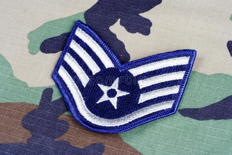US AIR FORCE Staff Sergeant rank patch on woodland camouflage uniform. Background royalty free stock photography