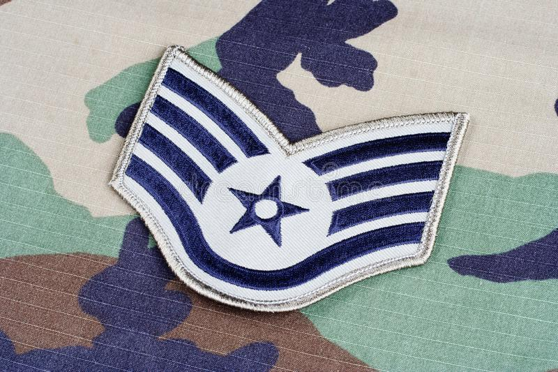 US AIR FORCE Staff Sergeant rank patch on woodland camouflage uniform. Background stock images