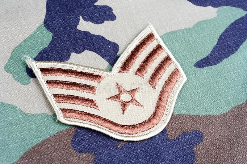 US AIR FORCE Staff Sergeant rank patch on woodland camouflage uniform. Background stock photography