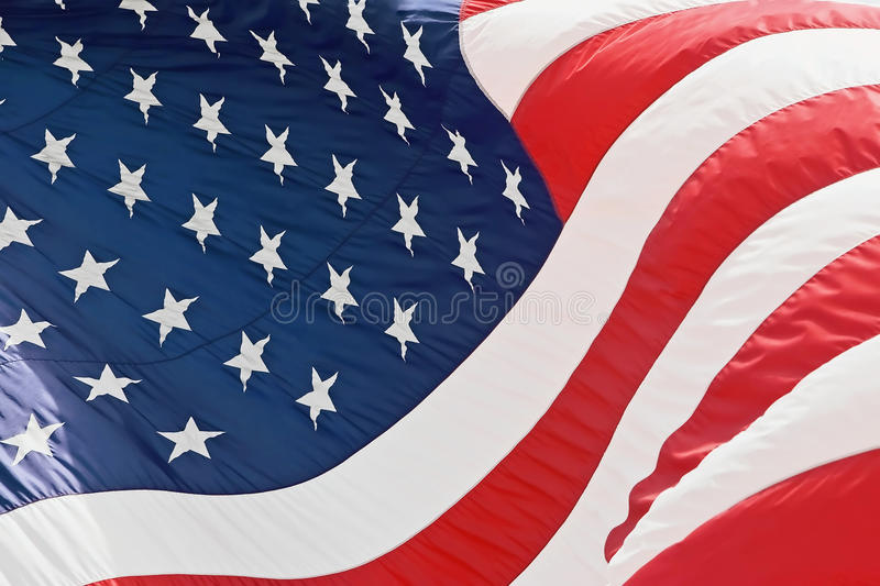US American Flag. United states of america USA flag background full frame outdoor lighting stock photography