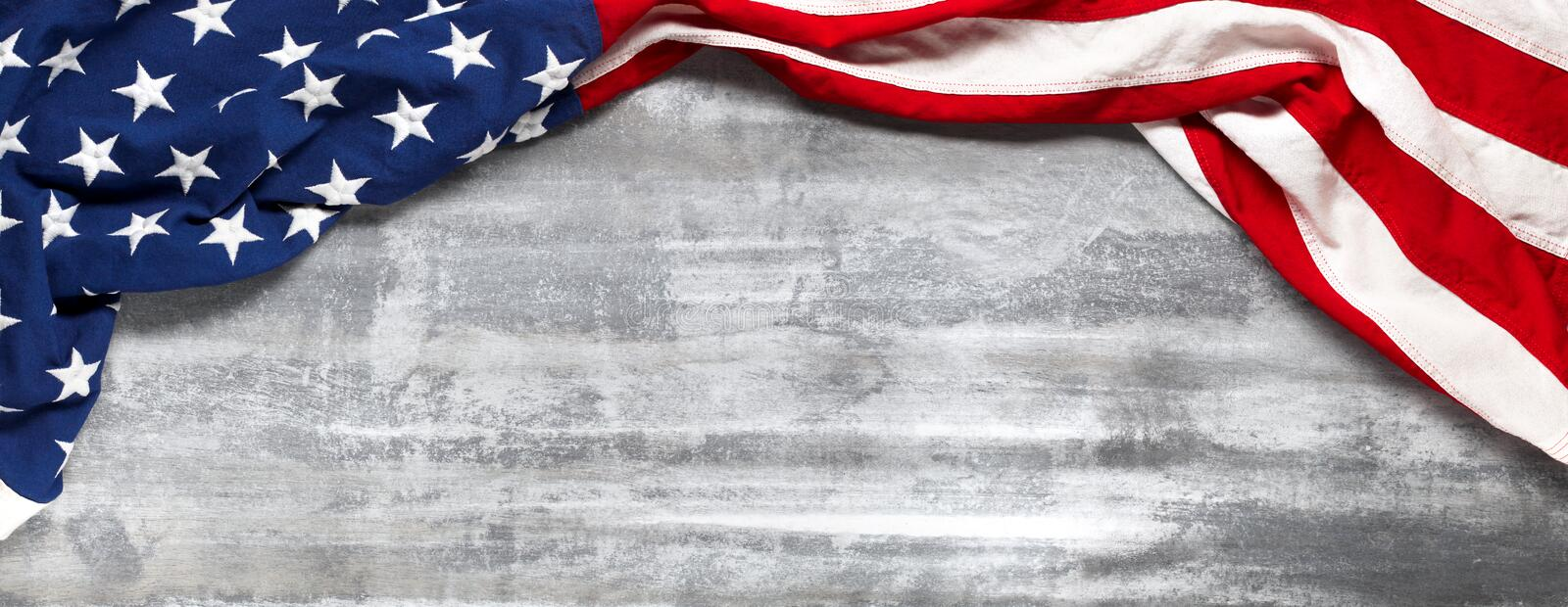 US American flag on white wooden background. For USA Memorial day, Veteran`s day, Labor day, or 4th of July celebration. Wit. US American flag on worn white stock images