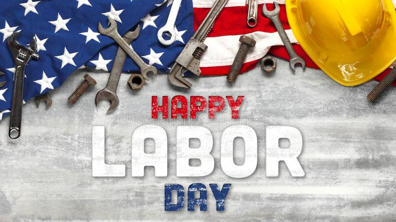 US American flag with work tools on white wooden background. For USA Labor day celebration. With Happy Labor Day text. US American flag with work tools on worn stock image