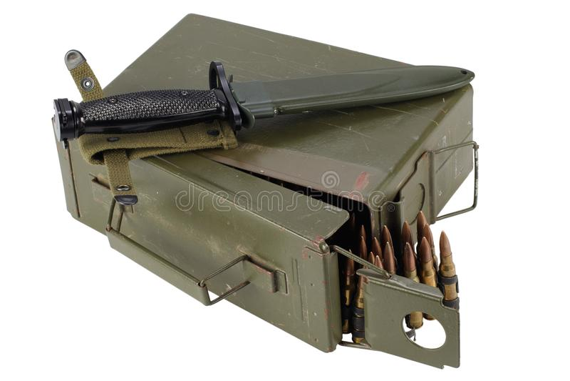 US Army Ammo Box with ammunition belt and bayonet. Isolated on white background royalty free stock photo
