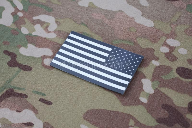 US ARMY flag patch on US ARMY uniform. US ARMY flag patch on US ARMY camouflage uniform royalty free stock photos