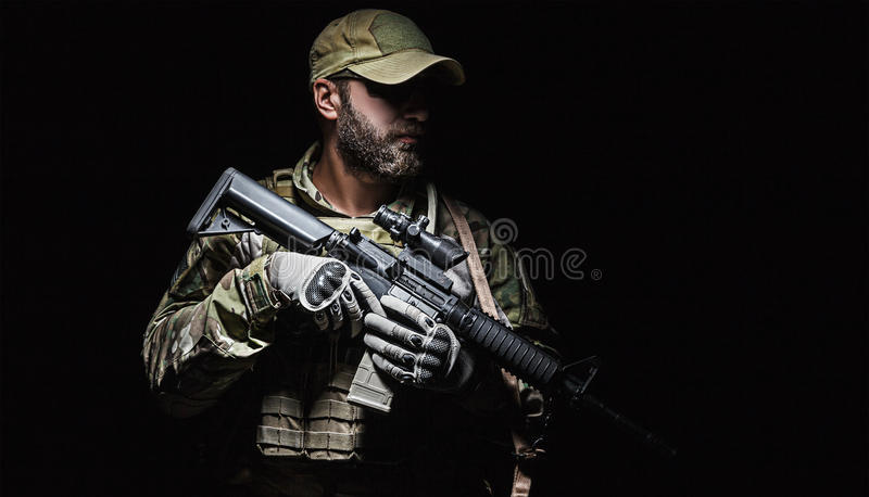 US Army Green Beret. Green Berets US Army Special Forces Group soldier studio shot stock photography