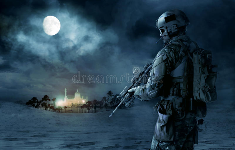 US Army Green Beret. Green Berets US Army Special Forces soldier patrolling desert. Cloudy night, full moon, oasis palace royalty free stock photography