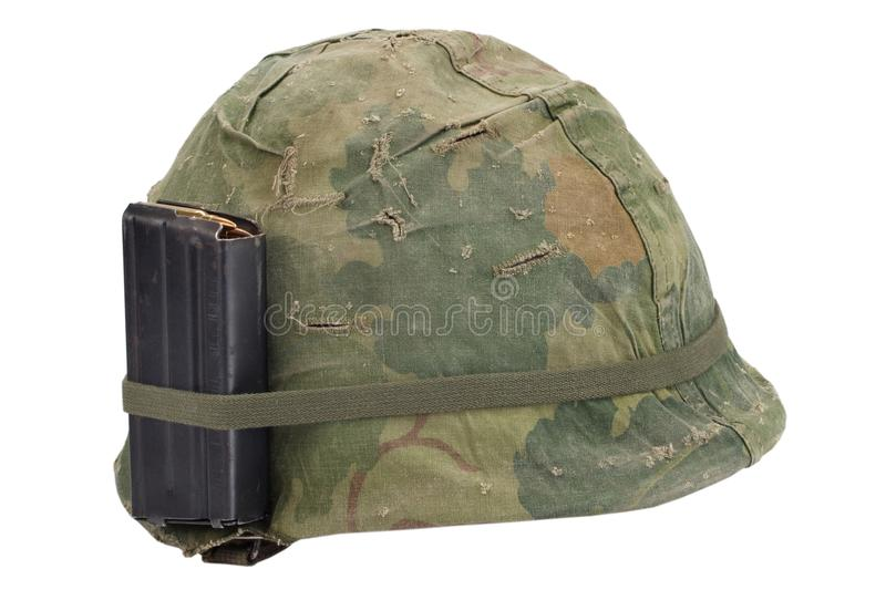 US Army helmet Vietnam war period with camouflage cover, magazine with ammo isolated. On white royalty free stock photos
