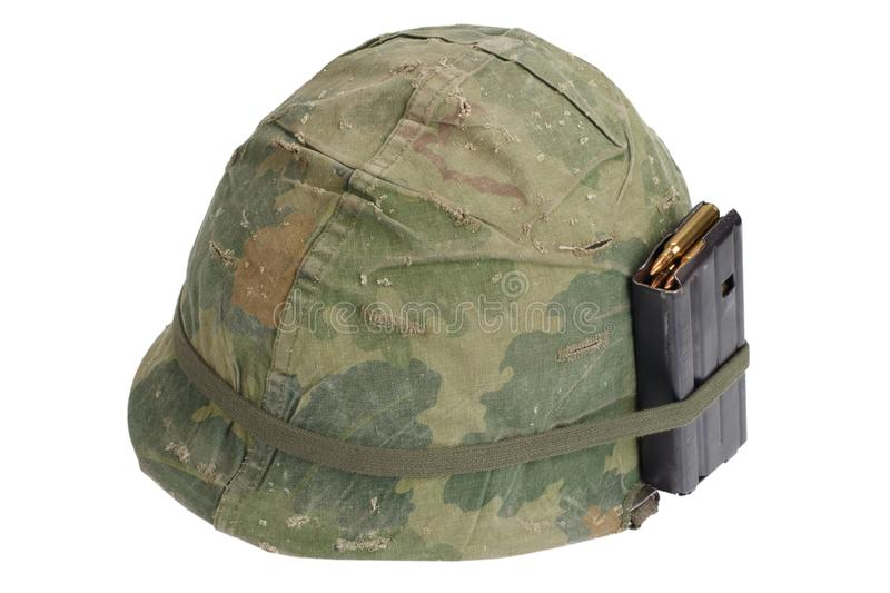 US Army helmet Vietnam war period with camouflage cover, magazine with ammo. Isolated on white royalty free stock photo