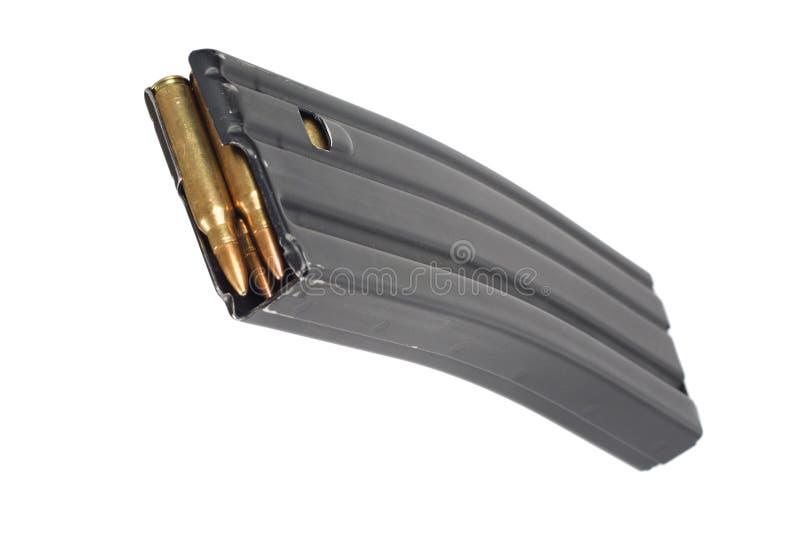 US ARMY M-16 rifle magazine with cartridges. Isolated on white background stock photos