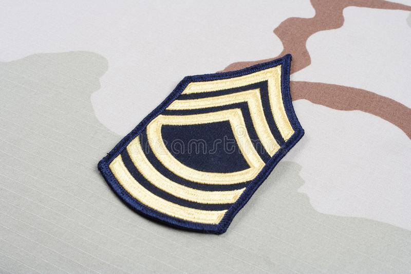 US ARMY Master Sergeant rank patch on desert uniform. Background royalty free stock image