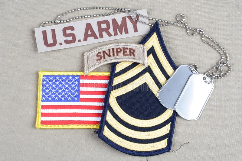 US ARMY Master Sergeant rank patch. Sniper tab, flag patch and dog tag stock photos
