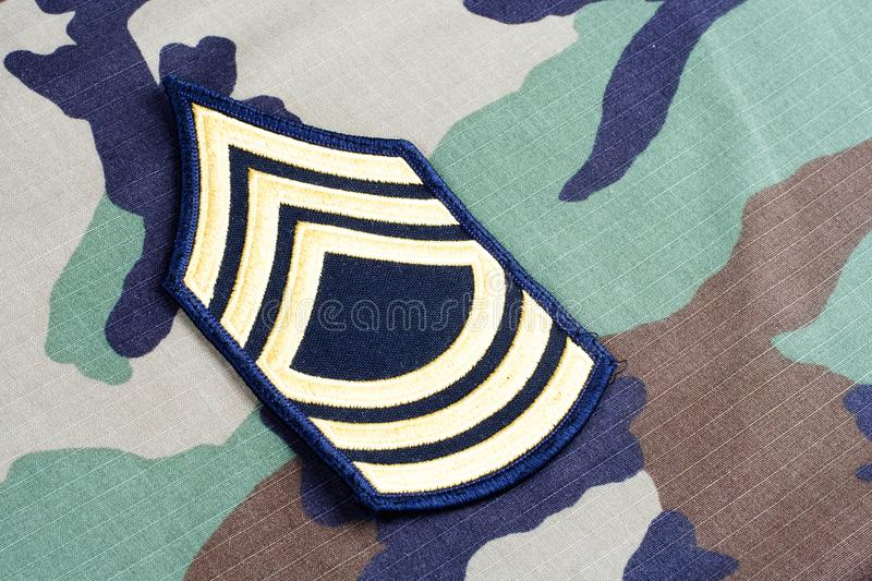 US ARMY Master Sergeant rank patch on woodland camouflage uniform. Background royalty free stock photography
