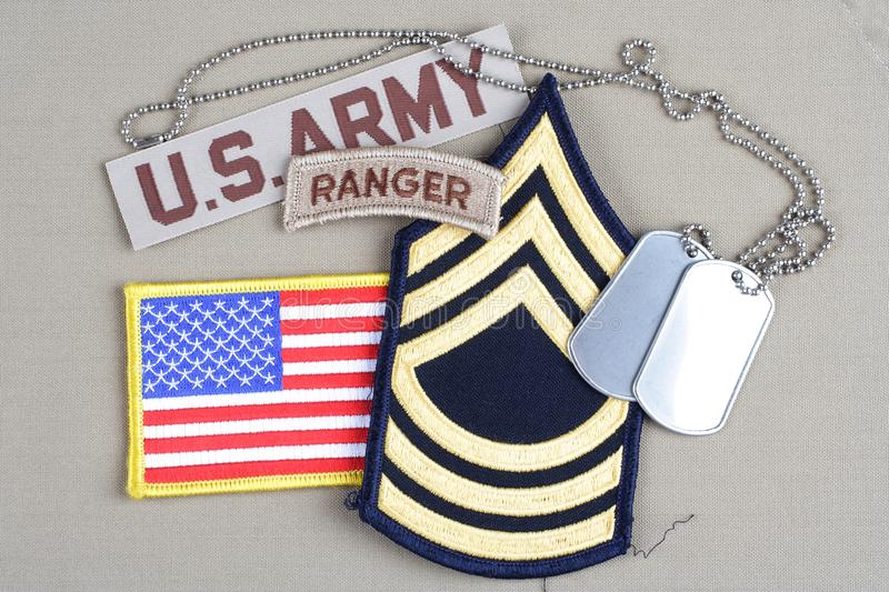 US ARMY Master Sergeant rank. Patch, ranger tab, flag patch and dog tag royalty free stock image