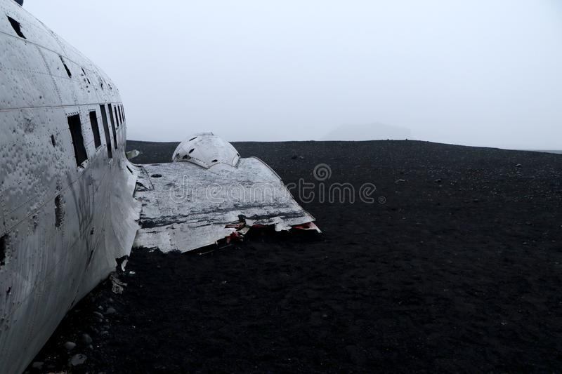 US army plane carcass stranded on black sand - Iceland royalty free stock photos