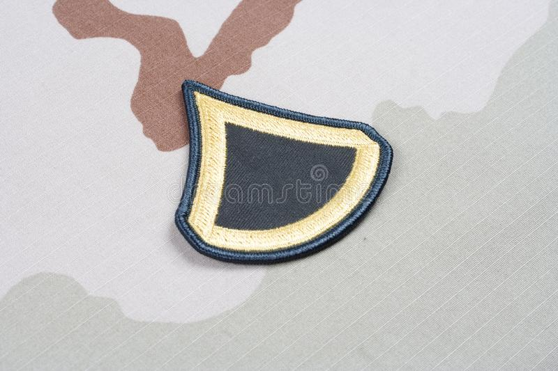 US ARMY Private First Class rank patch on desert uniform. Background royalty free stock image