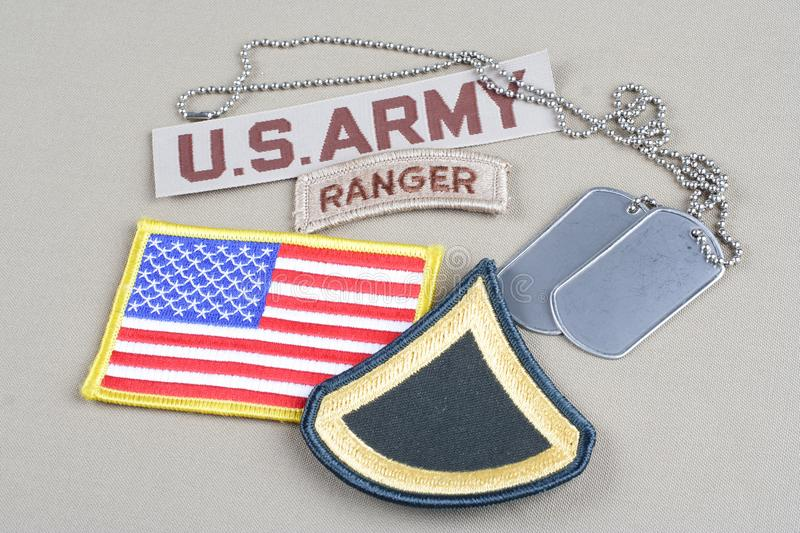 US ARMY Private First Class rank patch, ranger tab, flag patch and dog tag. Background royalty free stock photos