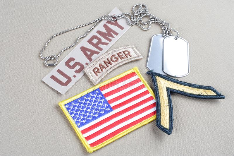 US ARMY Private rank patch, ranger tab, flag patch and dog tag. Background stock photography