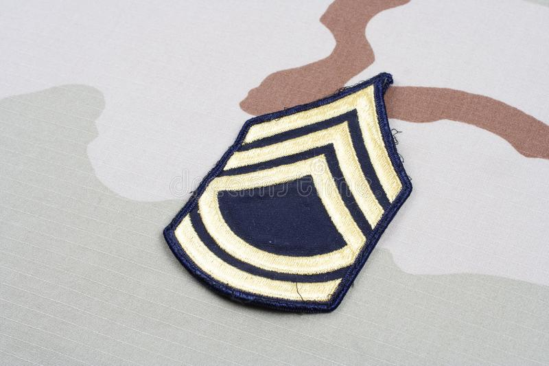 US ARMY Sergeant First Class rank patch. On desert uniform stock photos