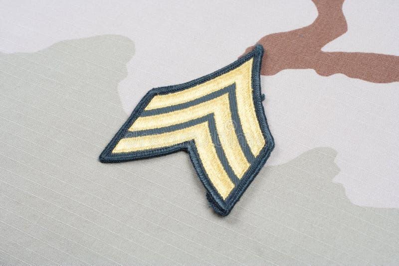 US ARMY Sergeant rank patch on desert uniform. Background stock photography