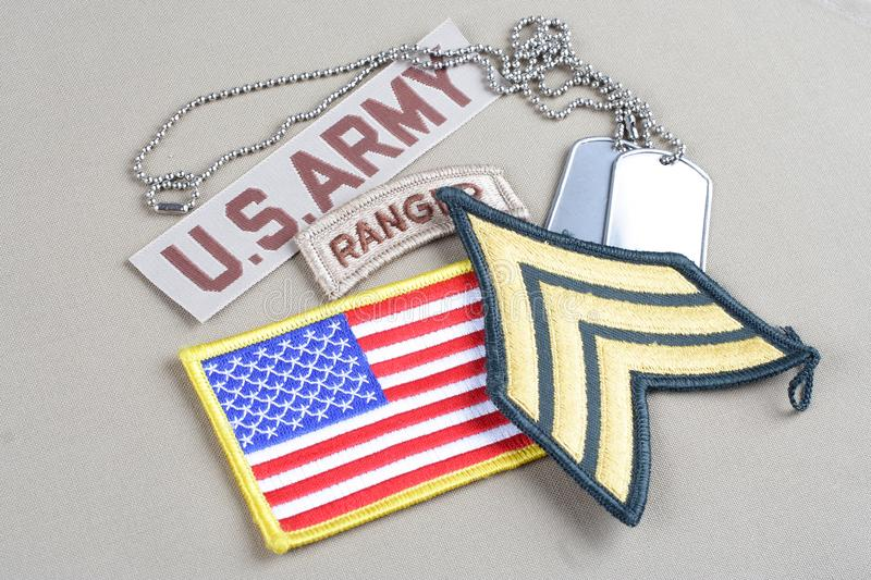 US ARMY Sergeant rank patch, ranger tab, flag patch and dog tag. Background royalty free stock images