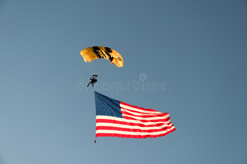 US Army Skydiver with US Flag. Folsom, CA, USA - July 4, 2010: US Army Skydiver with US Flag landing at Folsom rodeo royalty free stock photos