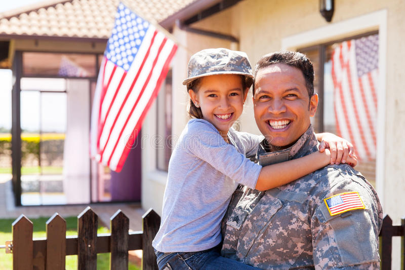 Us army soldier daughter. Portrait of us army soldier and little daughter outside their home