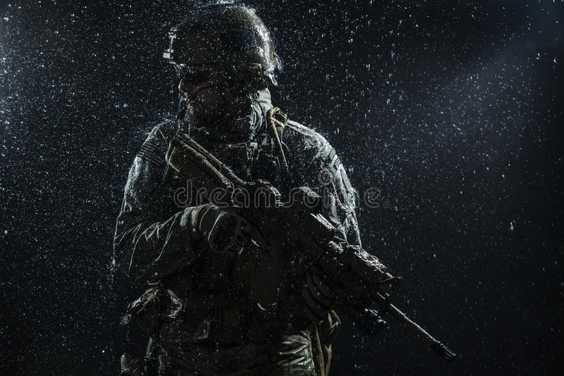 US Army soldier in the rain stock photos
