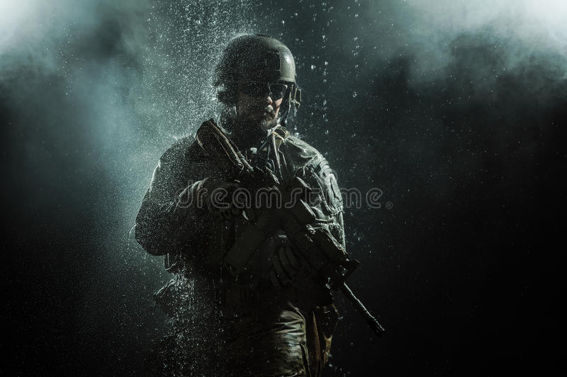 US Army soldier in the rain royalty free stock photography