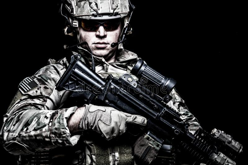 US army soldier with rifle on black background stock photo