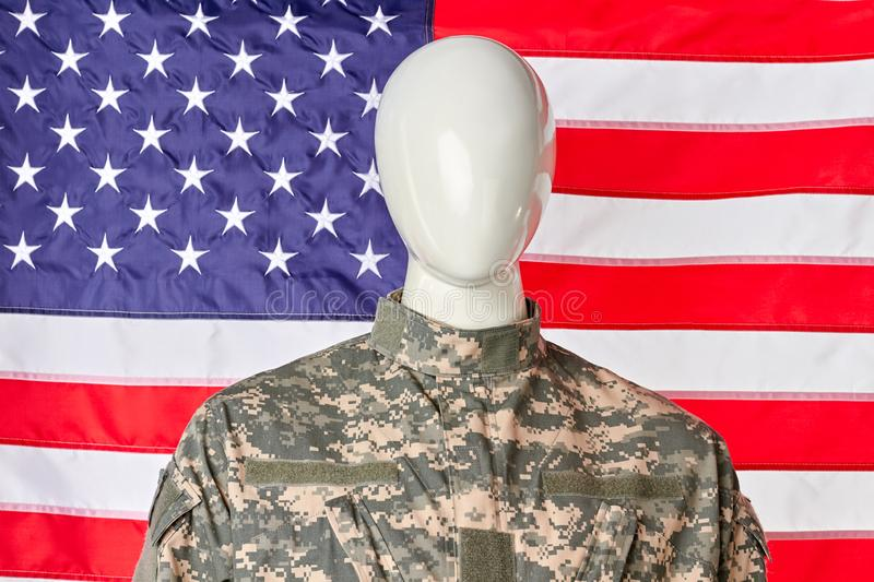 US army soldier uniform. Portrait of mannequin soldier against american flag background stock photos