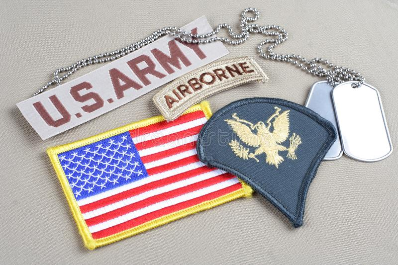 US ARMY Specialist rank patch,. Airborne tab, flag patch and dog tag background royalty free stock images