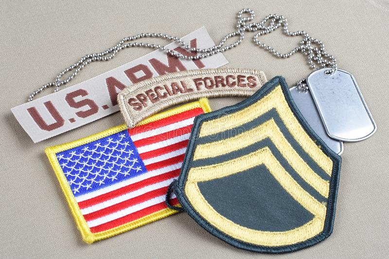 US ARMY Staff Sergeant rank patch. Special forces tab, flag patch and dog tag stock image