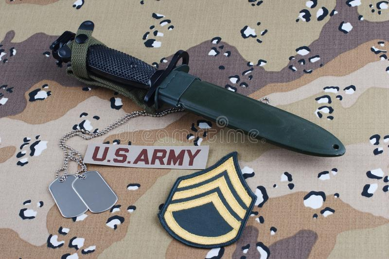 US ARMY uniform with bayonet and dog tags. US ARMY uniform with rank patch, bayonet and dog tags royalty free stock images