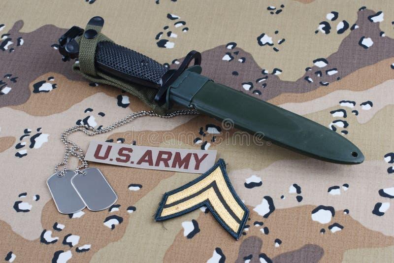 US ARMY uniform with bayonet and dog tags. US ARMY uniform with rank patch, bayonet and dog tags stock image