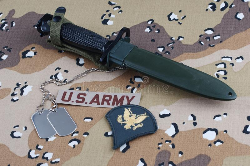 US ARMY uniform with bayonet and dog tags. US ARMY uniform with rank patch, bayonet and dog tags royalty free stock photos
