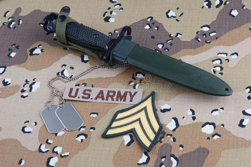 US ARMY uniform with bayonet and dog tags. US ARMY uniform with rank patch, bayonet and dog tags royalty free stock photo