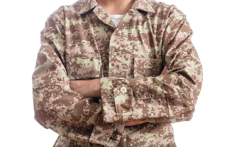 Young soldier with crossed arms isolated on white background stock photos