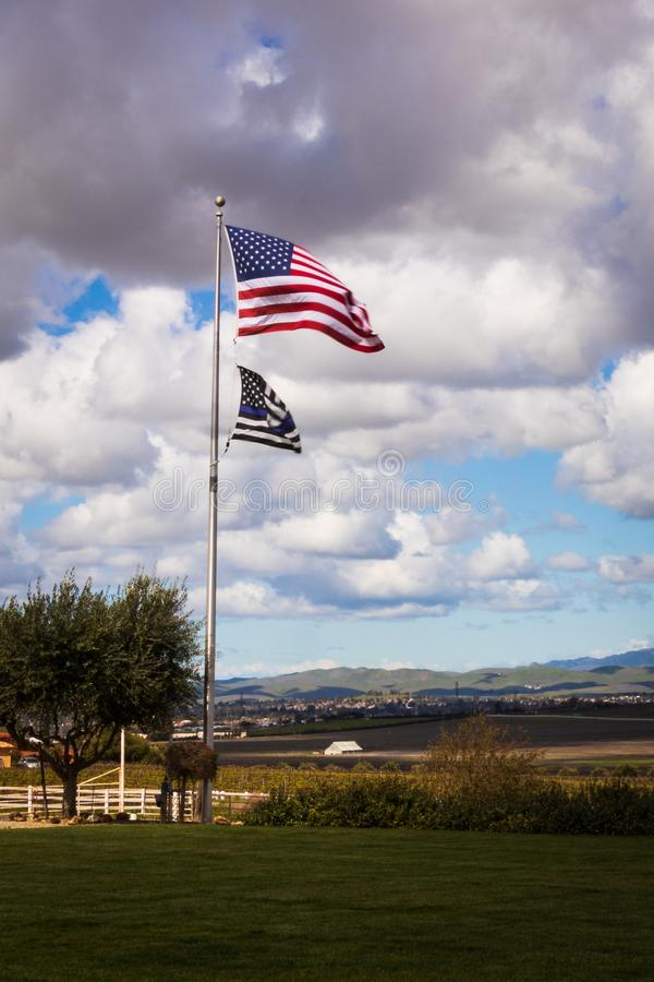 US and Blue Line Flag over Livermore Vineyards royalty free stock image