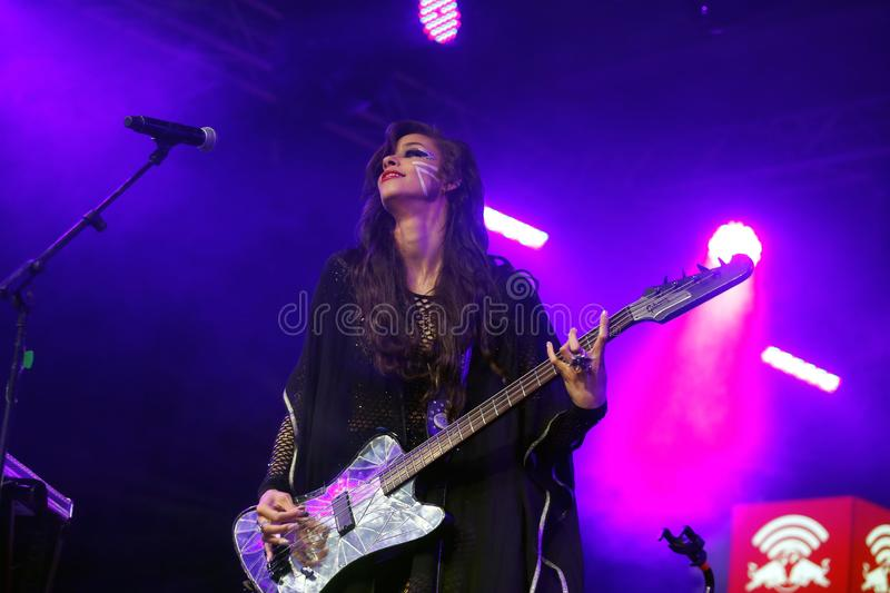 Simonne jones playing bass guitar live in barcelona. US born producer, singer, composer, model and visual artist based in Berlin Simonne Jones performs live at royalty free stock images