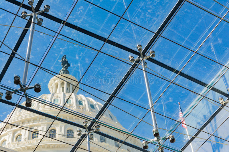 US Capitol Building Through Glass Windows Metal Chrome Supports. Freedom Statue royalty free stock photography