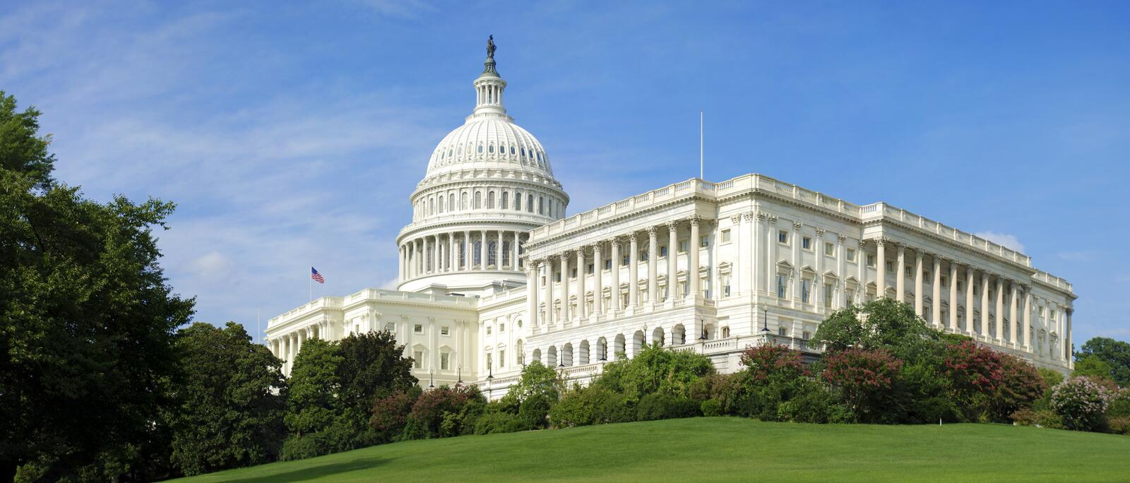 US Capitol building panorama. View of the U.S. Capitol building in downtown Washington D.C., USA, seat of the U.S. Senate and the U.S. Congress royalty free stock image