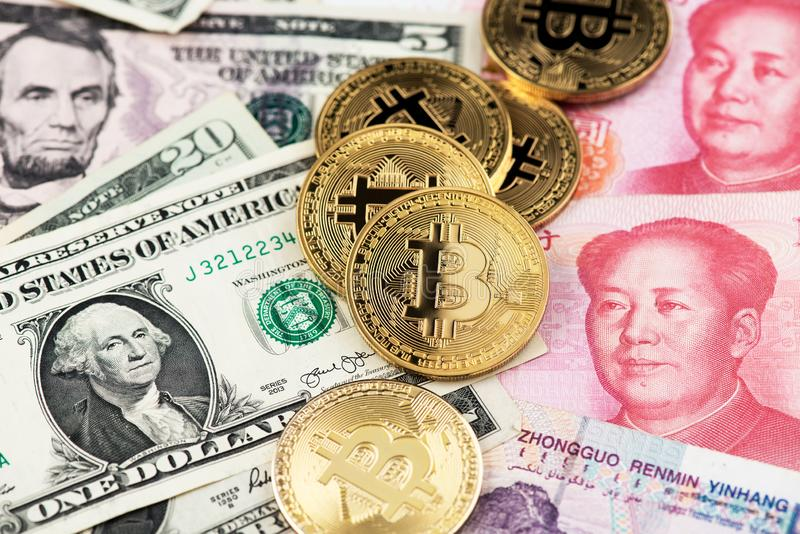 Bitcoin Cryptocurrency coins and US Dollar and Yuan China currency banknotes. US and China finance trade war concept. Bitcoin  Cryptocurrency coins and US royalty free stock photography