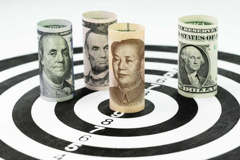 US and China financial trade war tariff strategy concept, US Dollar bank roll surround and targeting Chinese Yuan bank roll at th stock photography