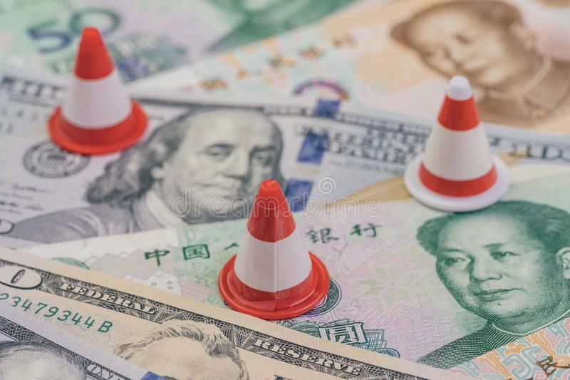 US and China Trade war and tariff reparation concept, small traffic cone for repair and under construction on United States stock image