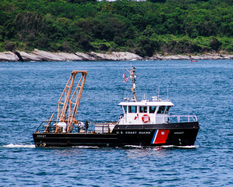US Coast Guard patrolling Narragansett Bay, RI. The United States Coast Guard out on patrol during a parade of sail in Newport, Rhode Island royalty free stock photo
