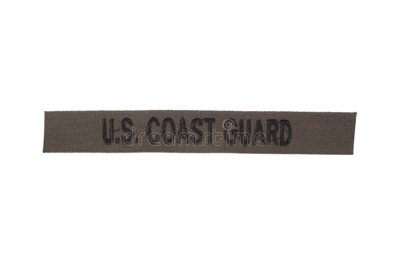 Us coast guard uniform badge. Isolated on white royalty free stock photography